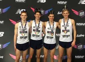 Staples Ben Seiple, Luke Lorenz, Christian Myers, and William Landowne pose after breaking the school record 4xMile record at the New Balance Indoor National Championships last weekend. The Wreckers finished fourth.