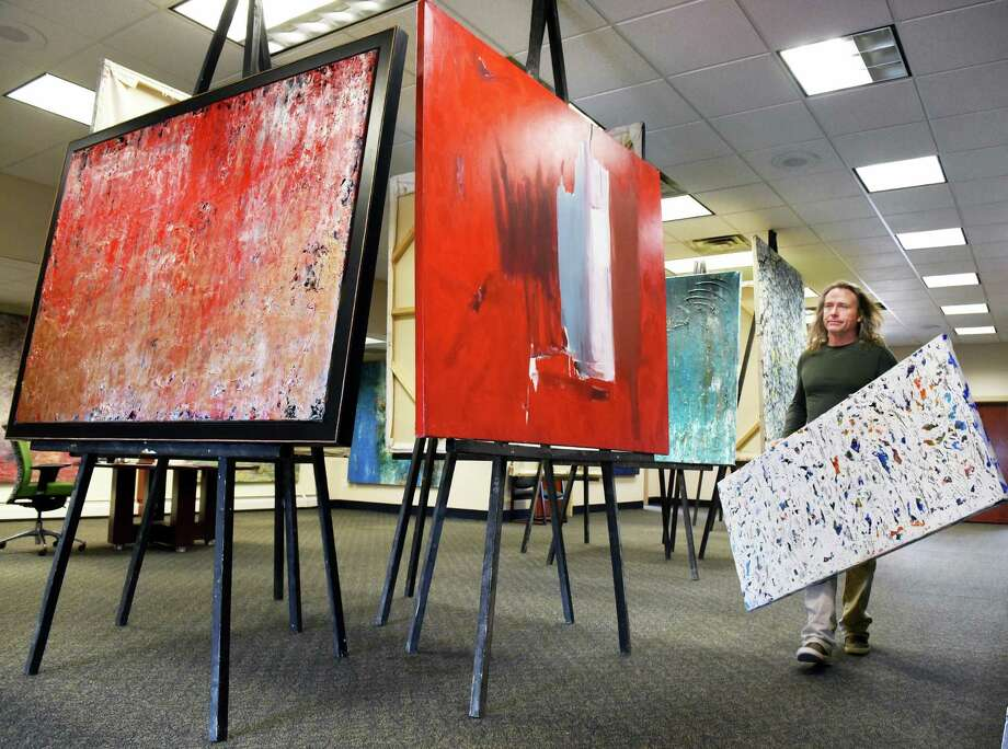 Artist Michael Nighswonger sets up 45 of his contemporary abstract acrylic on canvas works for a 10-day pop-up exhibit inside the old bank Thursday March 15, 2018 in Delmar, NY.  (John Carl D'Annibale/Times Union) Photo: John Carl D'Annibale, Albany Times Union / 20043234A