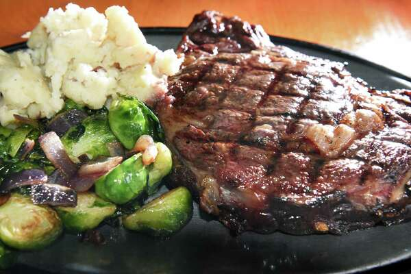 A Delmonico steak with Brussels sprouts and signature mashed potatoes at The Cock 'n Bull restaurant Thursday March 8, 2018 in Galway, NY.  (John Carl D'Annibale/Times Union)