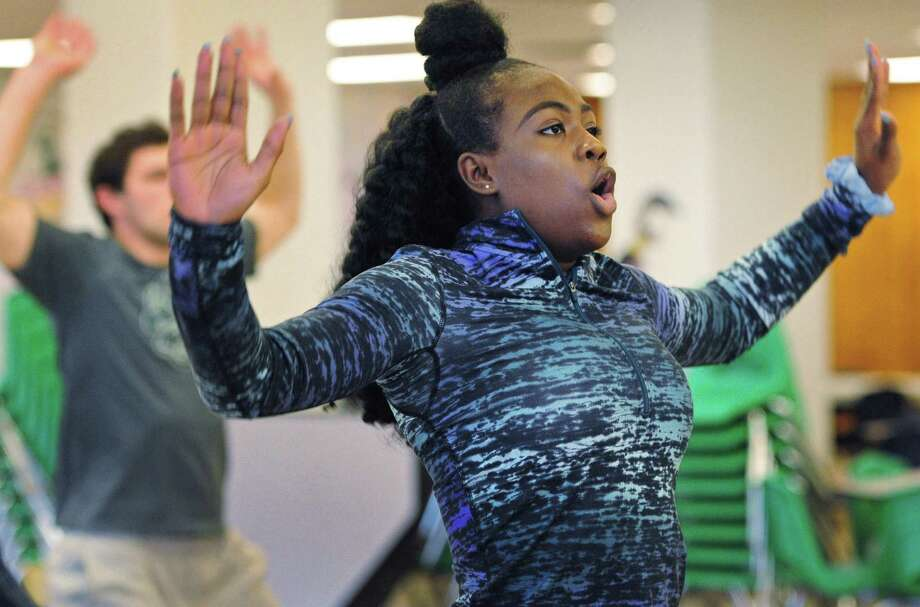 """Norwalk High School senior Jazmine Manning exercises with personal trainer Barry Horton during his Bootcamp in the cafeteria as students participate in the school's first Wellness Day Thursday, March 15, 2018, at the school in Norwalk Conn. Volunteers from more than 20 local organizations lead workshops and seminars on different aspects of wellness. A screening of a documentary called """"Angst"""" was also be played throughout the day for students. Photo: Erik Trautmann / Hearst Connecticut Media / Norwalk Hour"""