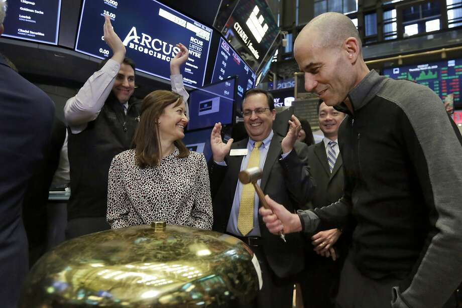 Arcus Biosciences Founder and CEO Terry Rosen, right, is applauded as he rings a ceremonial bell when his company's IPO begins trading on the floor of the New York Stock Exchange, Thursday, March 15, 2018. (AP Photo/Richard Drew) Photo: Richard Drew, Associated Press