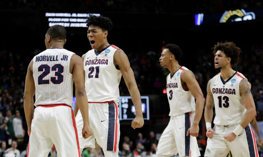Gonzaga's Zach Norvell Jr. (23) , Rui Hachimura (21), Johnathan Williams (3) and Josh Perkins (13) celebrate after Norvell Jr. made a three-point shot in the final minute of the second half of an NCAA college basketball tournament first-round game against UNC-Greensboro, Thursday, March 15, 2018, in Boise, Idaho. Gonzaga won 68-64. (AP Photo/Ted S. Warren) Photo: Ted S. Warren, Associated Press / Copyright 2018 The Associated Press. All rights reserved.