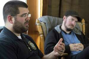 In this November 15, 2016 file photo, Matthew Heimbach, left, and Matt Parrott talk about plans to create an enclave in Paoli, Ind., for their followers in the Nationalist Workers Party. Heimbach, who was arrested for physically harassing a woman protesting at a 2016 Donald Trump rally, is now accused of attacking his wife and her stepfather in southern Indiana. He was charged Tuesday, March 13, 2018, with battery and domestic battery committed in the presence of a child under 16. He was released after posting bail. The leader of the Traditionalist Worker Party is accused of choking his wife's stepfather and attacking his wife Tuesday in Paoli. (David Snodgress/The Herald-Times via AP)