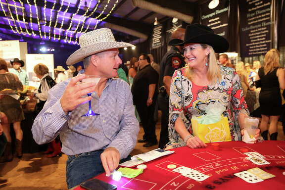 Wendy Vandeventer and Greg Liles play blackjack at Cattle Baron's Ball at George Ranch Historical Park Saturday, April 29, 2017, in Richmond. ( Yi-Chin Lee / Houston Chronicle )