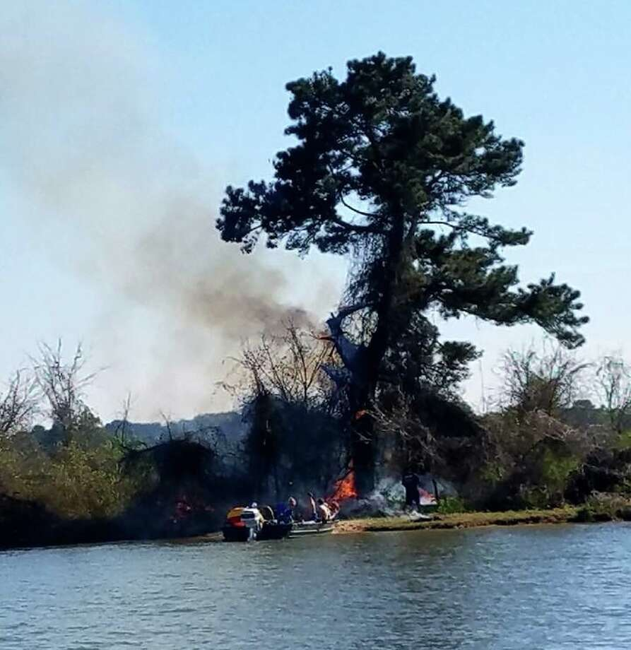 At approximately 4:30 p.m. on Wednesday, March 14, witnesses reported to Pct. 1 dispatch that a male, a female and children were seen leaving in a smaller boat, but the bigger boat on the island remained on fire. Photo: MCP1 Lake Patrol