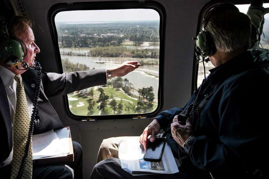 Dave Martin, Houston city councilman, District E, left, speaks to Gov. Greg Abbott as they take an aerial tour over the San Jacinto River, downstream from Lake Conroe, on Thursday, March 15, 2018, in Houston. The Kingwood area suffered serious flooding during Hurricane Harvey due in part to sand washed downstream from sand mining operations along the river. Photo: Brett Coomer, Houston Chronicle / © 2018 Houston Chronicle