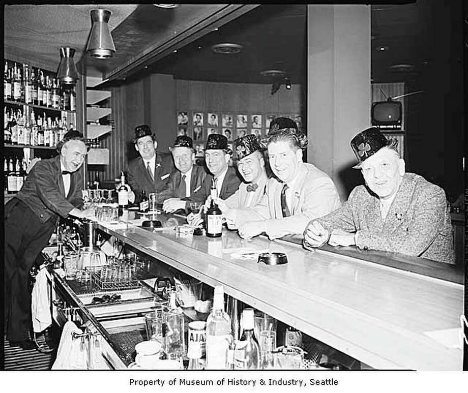 El Gaucho interior showing men at the bar on St. Patrick's Day, Seattle, March 17, 1959.  Courtesy of Mohai, Robert H. Miller Collection, 2002.46.15 Photo: Robert H. Miller, MOHAI / MOHAI