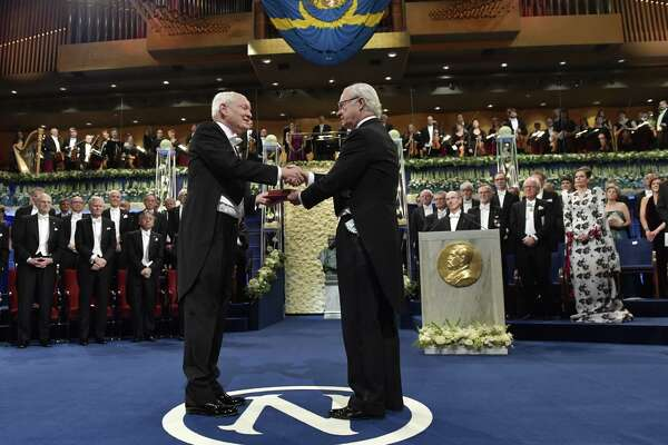 Joachim Frank, laureate in chemistry, receives his Nobel Prize from King Carl Gustaf of Sweden, right, during the Nobel award ceremony at the Concert house in Stockholm, Sweden, Sunday Dec. 10, 2017.