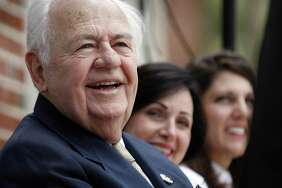 "Saints owner Tom Benson listens to remarks by Fr. Ted Dziak, S.J. on the steps of the former library at Loyola University. On Thursday, September 23, 2010, Benson donated $8 million to establish the Tom Benson Jesuit Center at Loyola University. Benson, who was hospitalized with the flu Feb. 16, ""passed away peacefully today at Ochsner Medical Center with his wife Gayle Marie Benson at his side,"" the New Orleans Saints said on Twitter Thursday."
