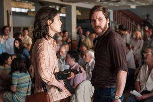 Rosamund Pike as Brigitte Kuhlman and Daniel Bruhl as Wilfred Bose in the new film by José Padilha. (Liam Daniel / Focus Features)