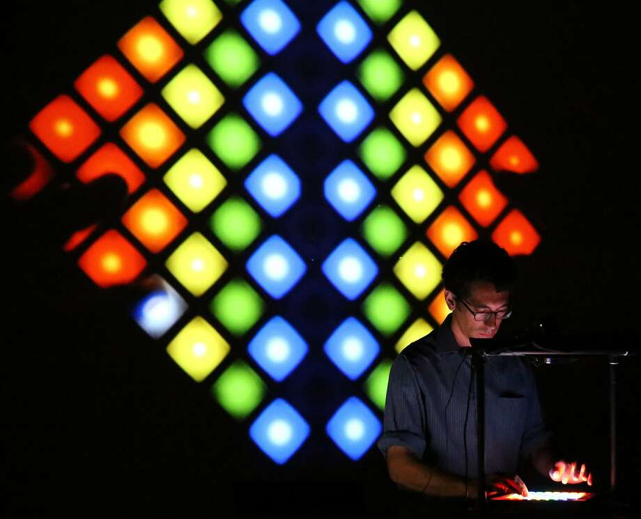 Composer Daniel Corral uses lights to illustrate his music. Photo: Steven Gunther