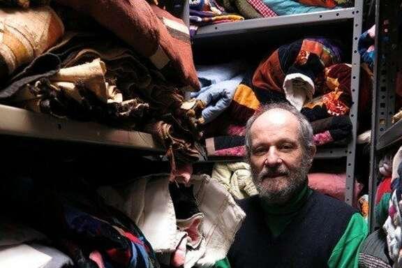 Eli Leon in his quilt storage room