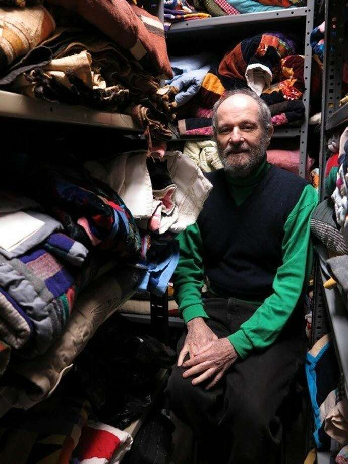 Eli Leon in his quilt storage room. Photo: Randi Malkin Steinbergeer