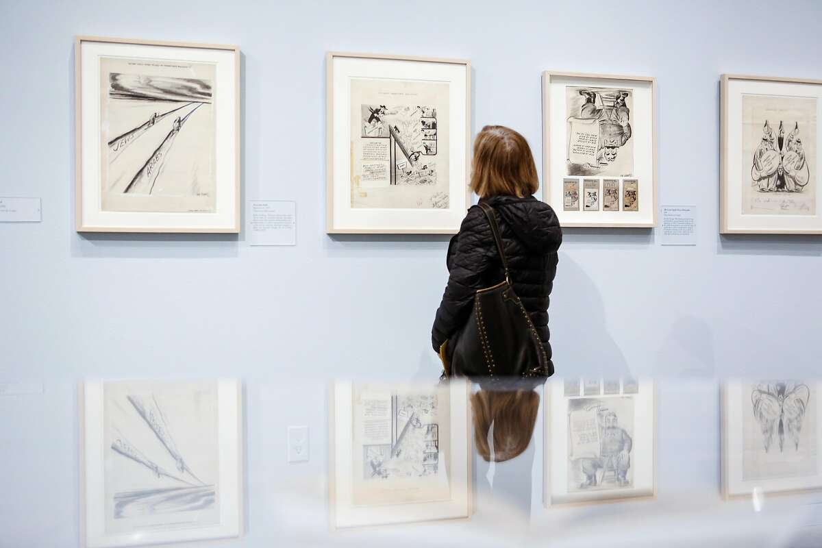 A woman looks over the Rube Goldberg exhibition at the Contemporary Jewish Museum during a press preview on Wednesday, March 14, 2018 in San Francisco, California. Goldberg was a noted San Francisco cartoonist who became nationally famous.