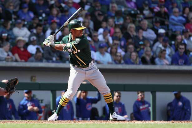 Khris Davis #2 of the Oakland Athletics bats against the Chicago Cubs during the spring training game at Sloan Park on February 28, 2018 in Mesa, Arizona. (