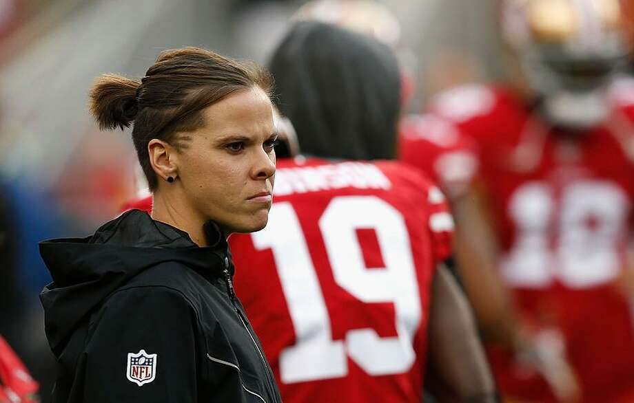 Seasonal Offensive Assistant Coach Katie Sowers looks on during the warm up before the game against the Seattle Seahawks at Levi's Stadium on November 26, 2017 in Santa Clara, California. Photo: Lachlan Cunningham / Getty Images / 2017 Getty Images