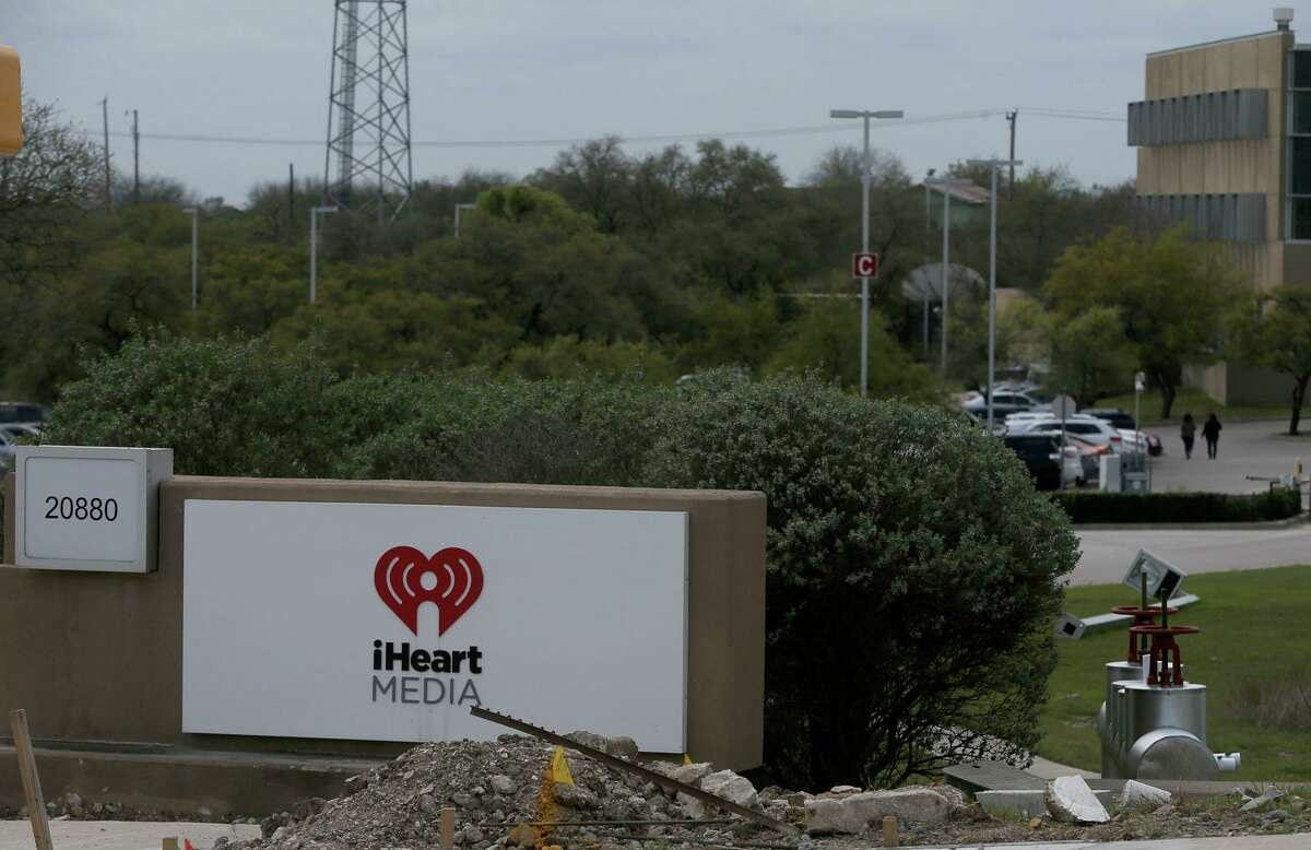 People walk in the parking lot Thursday March 15, 2018 at iHeart Media on San Antonio's North Side. San Antonio-based iHeartMedia Inc. filed for bankruptcy late Wednesday in Houston, following two years of litigation, speculation and financial gamesmanship as the nation's largest owner of radio stations tried to keep its crushing debt under control and creditors at bay. The company listed $12.3 billion in total assets and $20.3 billion in debt in its Chapter 11 bankruptcy petition.