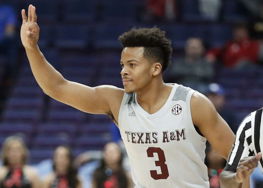 Texas A&M's Admon Gilder gestures after making a 3-point basket during the first half in an NCAA college basketball game at the Southeastern Conference tournament Thursday, March 8, 2018, in St. Louis. Photo: Jeff Roberson /Associated Press / Copyright 2018 The Associated Press. All rights reserved.