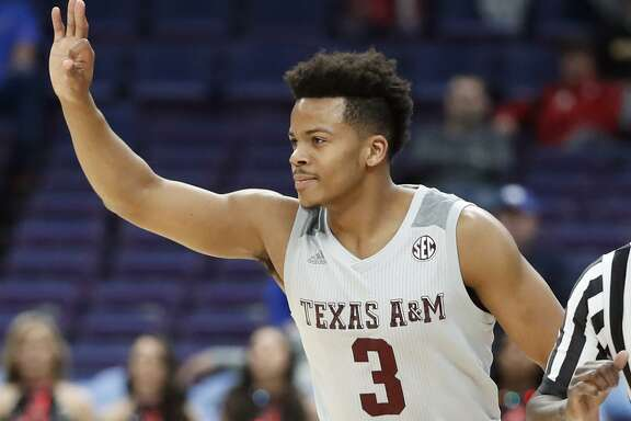 Texas A&M's Admon Gilder gestures after making a 3-point basket during the first half in an NCAA college basketball game at the Southeastern Conference tournament Thursday, March 8, 2018, in St. Louis.