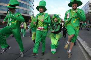 Costumed participants skip along as they compete in the St. Patrick's Day Dash on Sunday, March 17, 2013 in downtown Seattle. Thousands of green-clad people participated in the annual race and  beer fest at Seattle Center. (Joshua Trujillo, seattlepi.com)