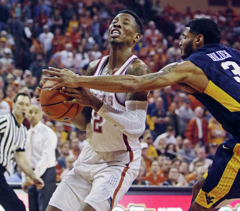 Texas guard Kerwin Roach, Jr., left, drives the ball against West Virginia guard James Bolden, right, during the second half of an NCAA college basketball game, Saturday, March 3, 2018, in Austin, Texas. Texas won 87-79. (AP Photo/Michael Thomas) Photo: Michael Thomas, FRE / Associated Press / FR65778 AP