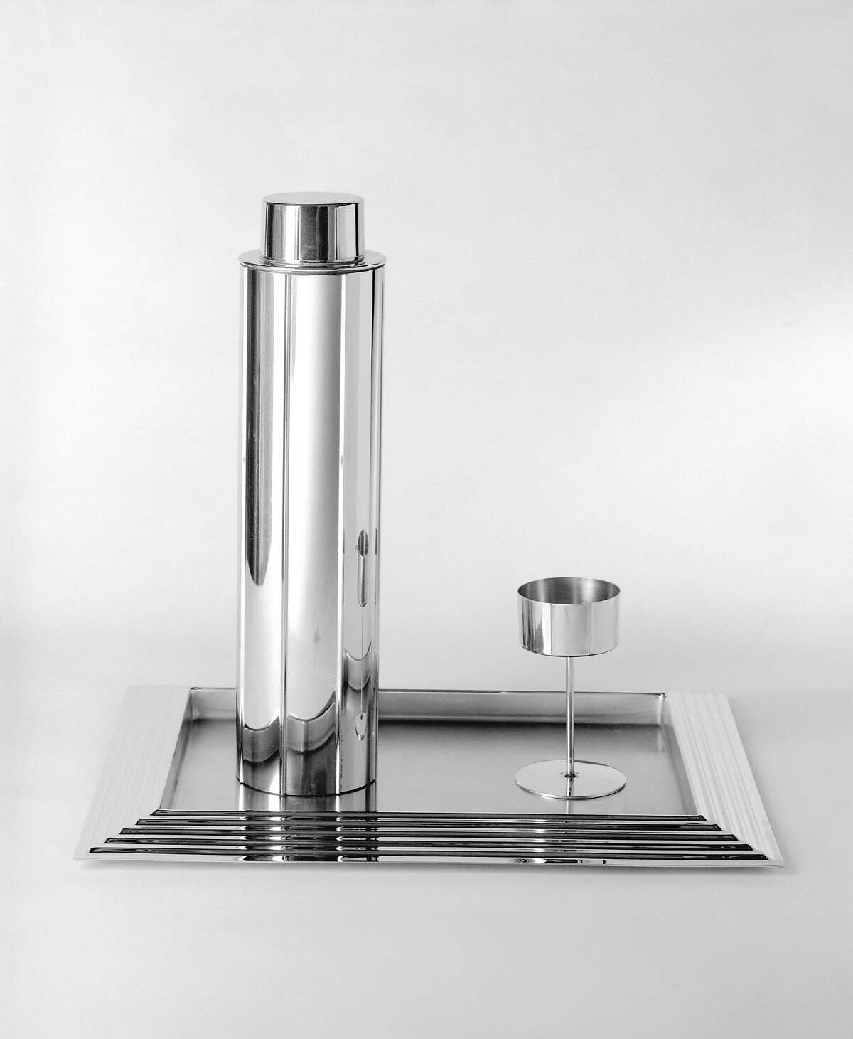 """Norman Bel Geddes, """"Skyscraper"""" cocktail shaker, glass and serving tray, designed 1934, manufactured 1935."""