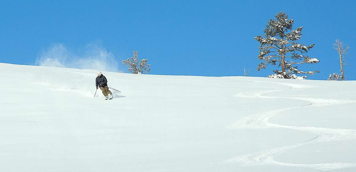A skier sails down virgin corduroy at Northstar Resort at North Tahoe after the ski area received 19 inches in 48 hours.