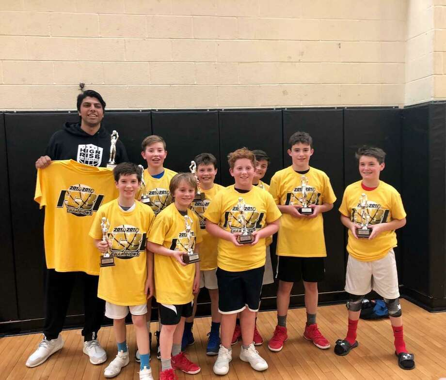 The Greenwich Select Boys Red Team, a squad that is part of High Rise Basketball Academy, captured its division title at the Fairfield County Basketball League Championships recently at Fairfield Ludowe High School. Greenwich defeated Weston 43-30 in the championship game. Photo: /