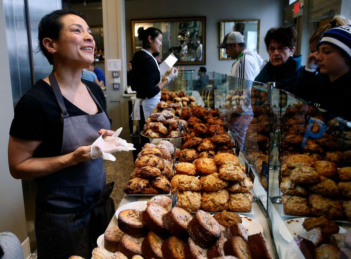 Co-owner Belinda Leong helps customers at b. Patisserie on California Street in San Francisco, Calif. on Saturday, March 10, 2018. Owners of the popular bakery are opening a shop in Seoul, South Korea next month.