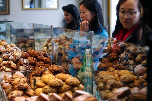 Customers order fresh pastry and breads at b. Patisserie on California Street in San Francisco, Calif. on Saturday, March 10, 2018. Owners of the popular bakery are opening a shop in Seoul, South Korea next month.
