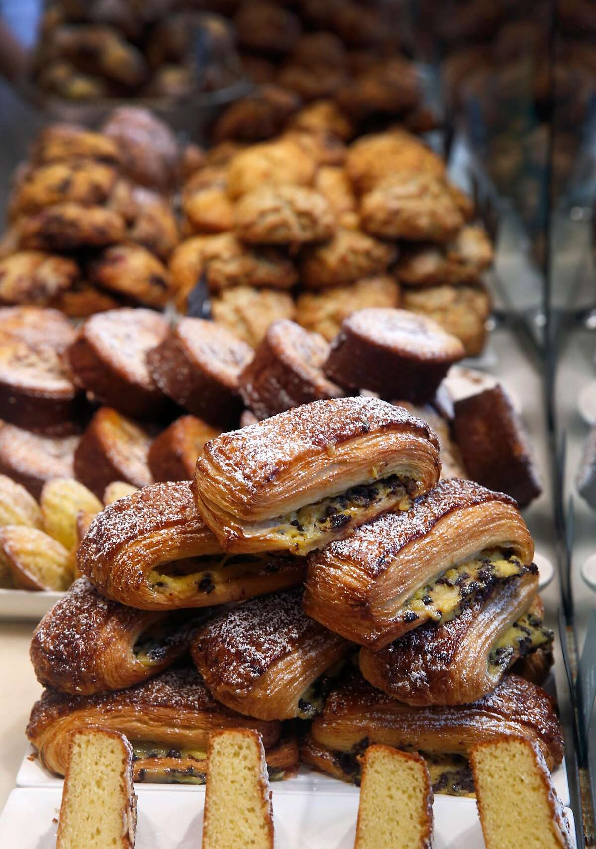 In this file photo, Fresh pastries are displayed at b. Patisserie on California Street in San Francisco. The bakery is one of several participating in a bake sale benefiting local children.