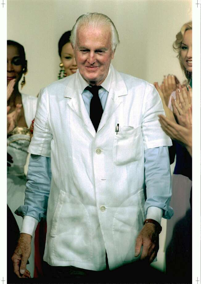 PAR03:FRANCE-FASHION:PARIS,FRANCE,16OCT95- Hubert de  Givenchy is applauded by  models at the end of his 1996 spring/summer ready to wear collection show in    Paris October 16. de Givenchy takes last bow of his 43-year career before       passing the thimble to British designer John Galliano.   ws/mal/Photo by Eric   Gaillard REUTERS Photo: ERIC GAILLARD, REUTERS