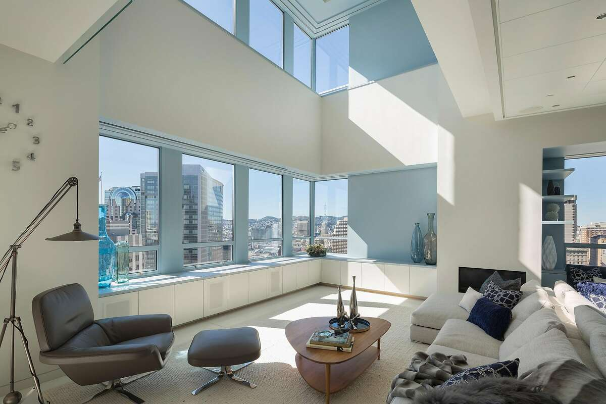 A double-height ceiling shelters the living area.