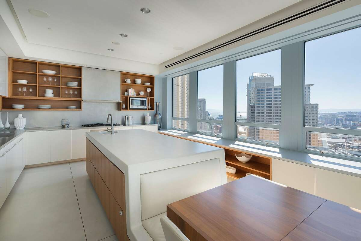 The kitchen island includes built-in seating.