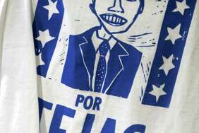 "Artist Cruz Ortiz silk- screened ""Beto por Tejas"" T-shirts last month at a town hall in San Antonio."