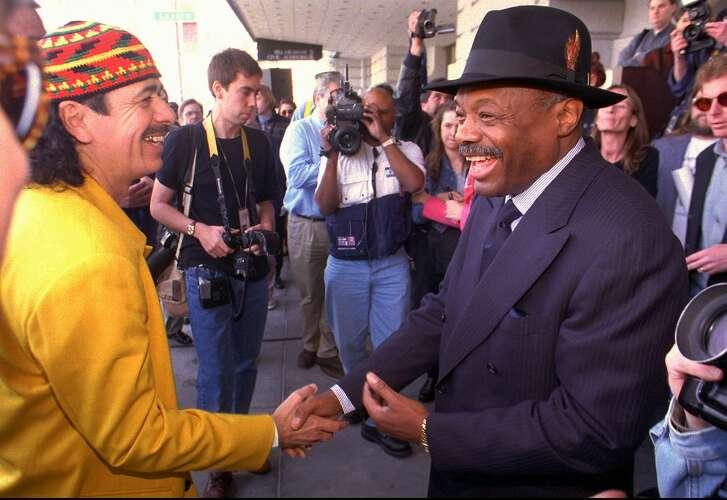 """Musician Carlos Santana (left) is congratulated by San Francisco Mayor Willie Brown at the unveiling of the """"Bammie Walk of Fame"""" plaques honoring Santana, music promoter Bill Graham, and Greatful Dead vocalist/guitarist Jerry Garcia in front of the Bill Graham Civic Auditorium Wednesday, March 12, 1997, in San Francisco, Calif. The three plaques were dedicated to be a tribute to individuals who have made exceptional contributions of the musical heritage of the San Francisco Bay Area. The 20th annual Bay Area Music Awards (Bammies) will be held Saturday, March 15, in San Francisco. (AP Photo/Thor Swift) ALSO RAN :7/1/97"""