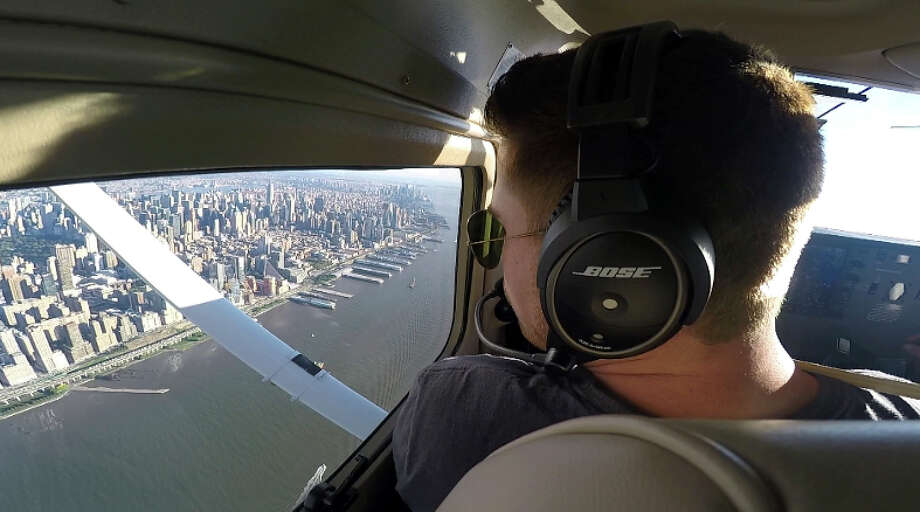 This Aug. 23, 2017, image made from a video Aaron Ludomirski, certified flight instructor for Infinity Flight Group, flies over the Hudson River in New York. Major U.S. airlines are hiring pilots at a rate not seen since before 9/11, and that is encouraging more young people to consider a career in the cockpit. (AP Photo/Joshua Replogle) Photo: Joshua Replogle / ap