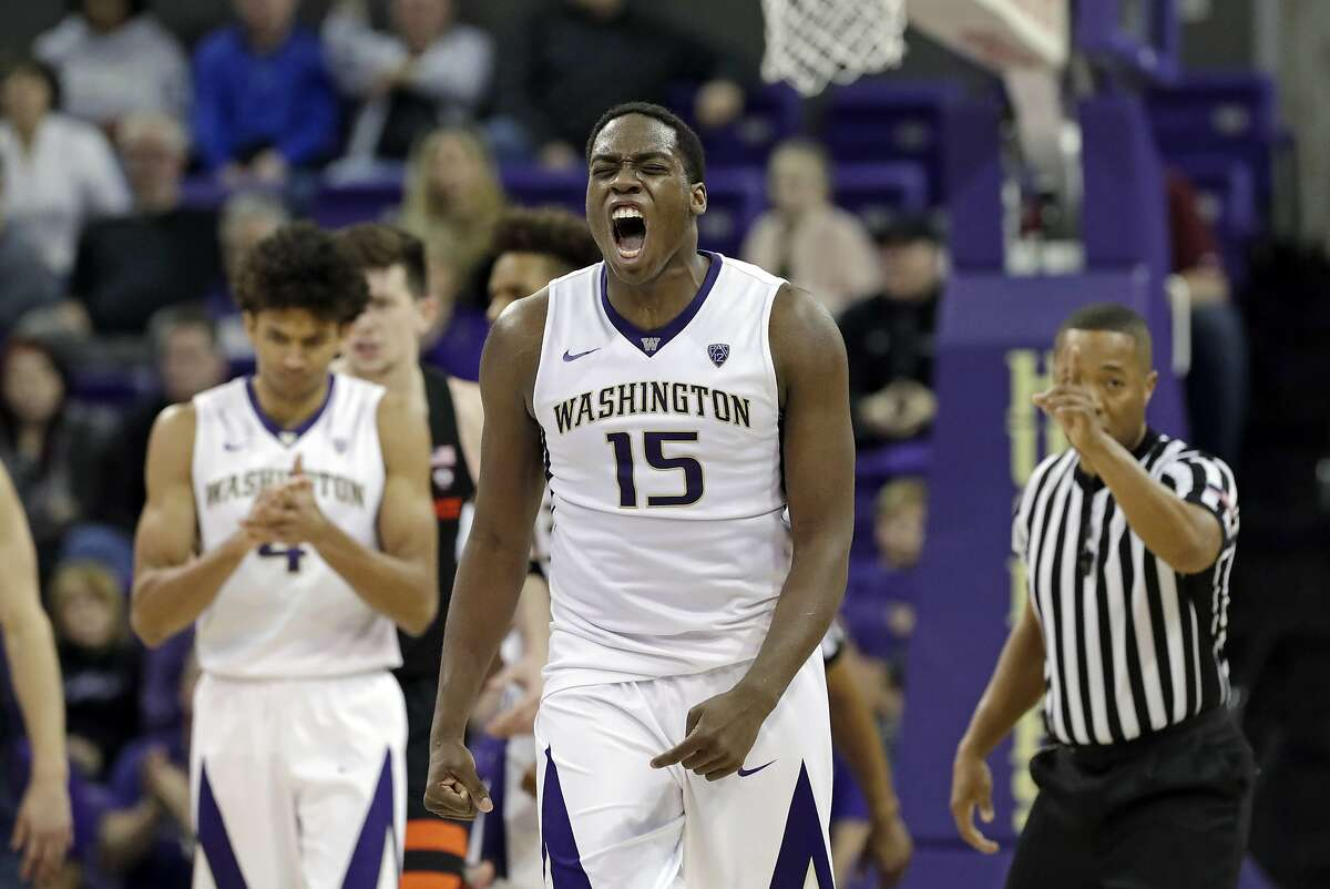 Washington's Noah Dickerson (15) lets out a yell after a call against Oregon State in the second half of an NCAA college basketball game Thursday, March 1, 2018, in Seattle. Dickerson led all scorers with 25 points and Washington won 79-77. (AP Photo/Elaine Thompson)