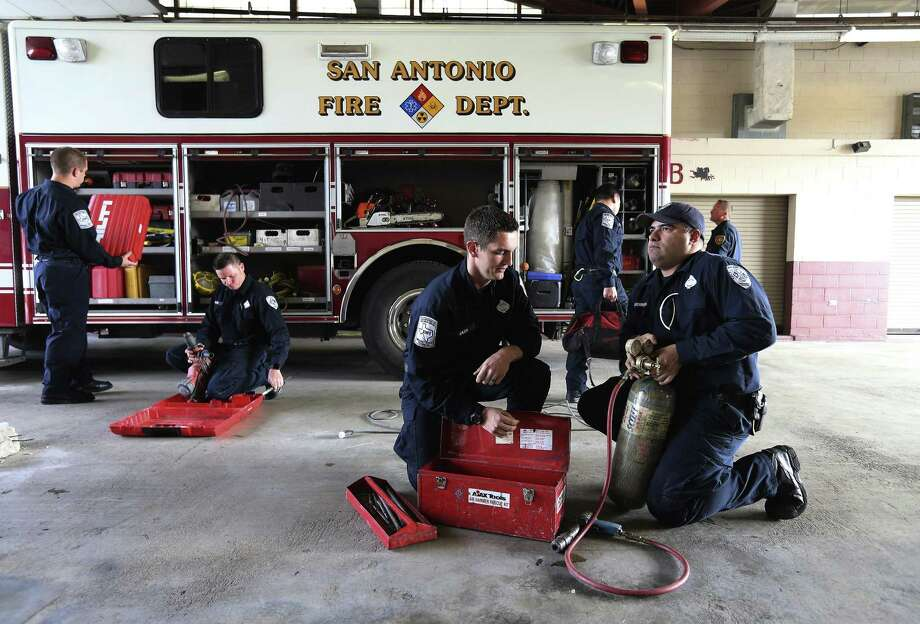 Firefighters Fernando Guerrero (right) and Adam Miles put away equipment at Station No. 11 on Thursday, Mar. 15, 2018 that was used in the extraction of a student stuck in Robber Baron Cave earlier this month. Guerrero and Miles were amongst the first responders who, on March 9, with more than 75 firefighters took part in the rescue of an 18-year-old Lee High School student who was trapped in the Robber Baron Cave. Some of those who took part in the effort will be discussing the operation at Station No. 11's Technical Rescue Unit. Using a process of harnesses, chipping away at the rock and even using Dawn liquid soap eventually helped the firefighters extract the student from the cave. (Kin Man Hui/San Antonio Express-News) Photo: Kin Man Hui, Staff / San Antonio Express-News / ©2018 San Antonio Express-News