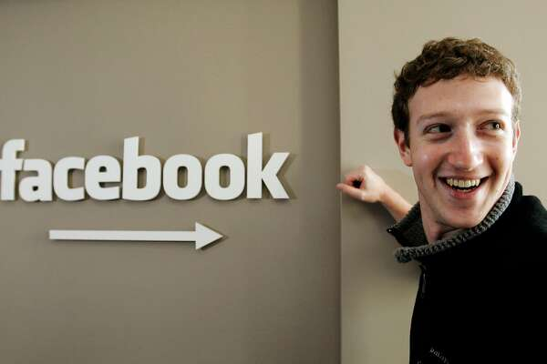In this Feb. 5, 2007 file photo, Facebook CEO Mark Zuckerberg smiles in this office in Palo Alto, Calif. Zuckerberg turns 28 on Monday, May 14, 2012. He's considerably younger than the average FORTUNE 500 CEO, of course. But while some investors worry that Zuckerberg is too young to lead Facebook as a public company, experts point out that Bill Gates, Steve Jobs and Michael Dell were in their 20s when their companies had IPOs. (AP Photo/Paul Sakuma, File)