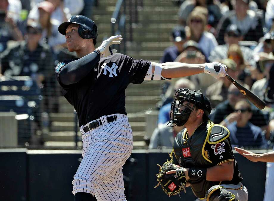 New York Yankees' Aaron Judge follows the flight of his RBI double off Pittsburgh Pirates starting pitcher Joe Musgrove during the first inning of a spring training baseball game Thursday, March 15, 2018, in Tampa, Fla. Yankees' Brett Gardner scored on the hit. Catching for the Pirates is Francisco Cervelli. (AP Photo/Chris O'Meara) Photo: Chris O'Meara / Copyright 2018 The Associated Press. All rights reserved.