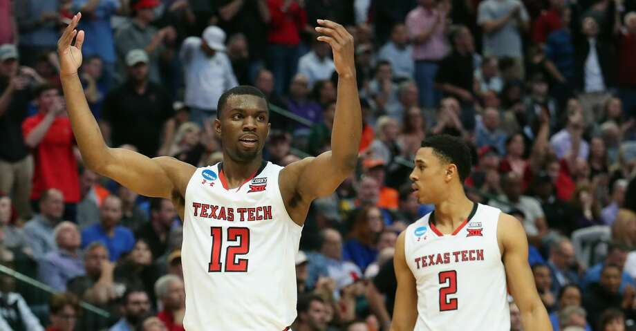 DALLAS, TX - MARCH 15:  Keenan Evans #12 of the Texas Tech Red Raiders celebrate alongside teammate Zhaire Smith #2 in the second half against the Stephen F. Austin Lumberjacks in the first round of the 2018 NCAA Men's Basketball Tournament at American Airlines Center on March 15, 2018 in Dallas, Texas. The Texas Tech Red Raiders won 70-60.  (Photo by Tom Pennington/Getty Images) Photo: Tom Pennington/Getty Images