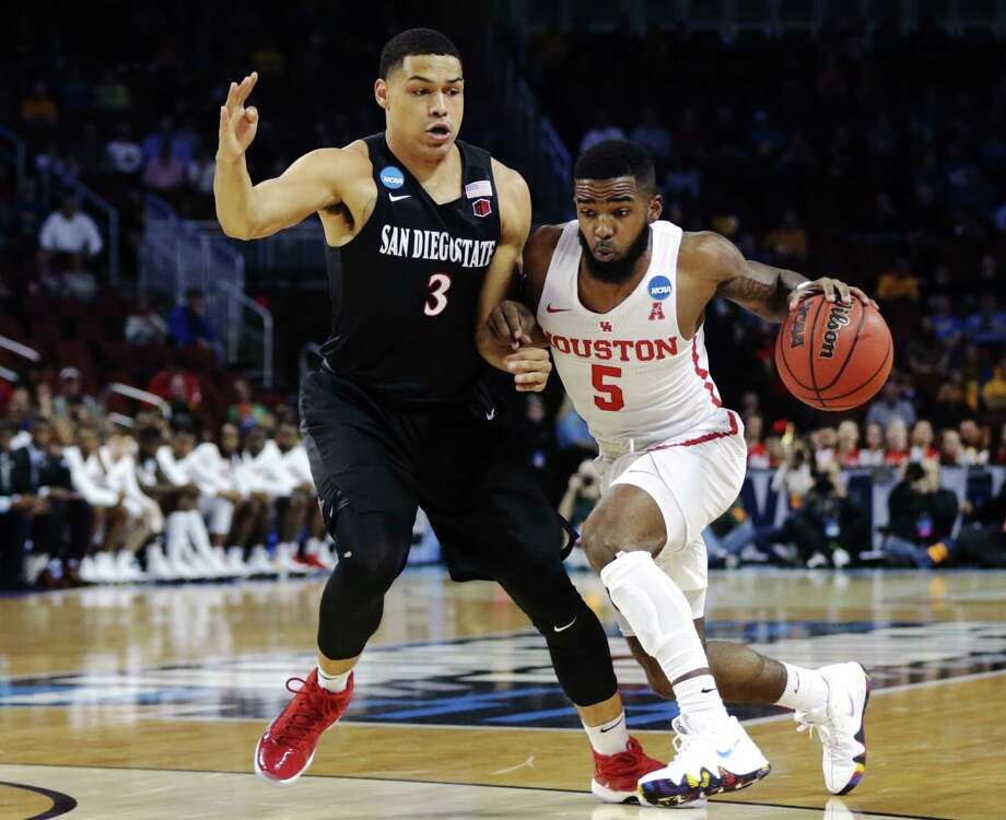 WICHITA, KS - MARCH 15: Corey Davis Jr. #5 of the Houston Cougars is defended by Trey Kell #3 of the San Diego State Aztecs during the first half of the first round of the 2018 NCAA Men's Basketball Tournament at INTRUST Arena on March 15, 2018 in Wichita, Kansas.  (Photo by Jeff Gross/Getty Images) Photo: Jeff Gross, Stringer / 2018 Getty Images