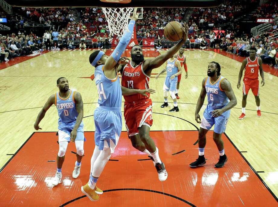 Houston Rockets' James Harden (13) goes up for a shot as LA Clippers' Tobias Harris (34) defends during the first half of an NBA basketball game Thursday, March 15, 2018, in Houston. (AP Photo/David J. Phillip) Photo: David J. Phillip, STF / Copyright 2018 The Associated Press. All rights reserved.