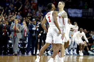 WICHITA, KS - MARCH 15:  Rob Gray #32 is congratulated by his teammate Armoni Brooks #3 of the Houston Cougars after scoring the game-winning basket against the San Diego State Aztecs during the second half of the first round of the 2018 NCAA Men's Basketball Tournament at INTRUST Arena on March 15, 2018 in Wichita, Kansas. The Houston Cougars defeated the San Diego State Aztecs 67-65.  (Photo by Jeff Gross/Getty Images)