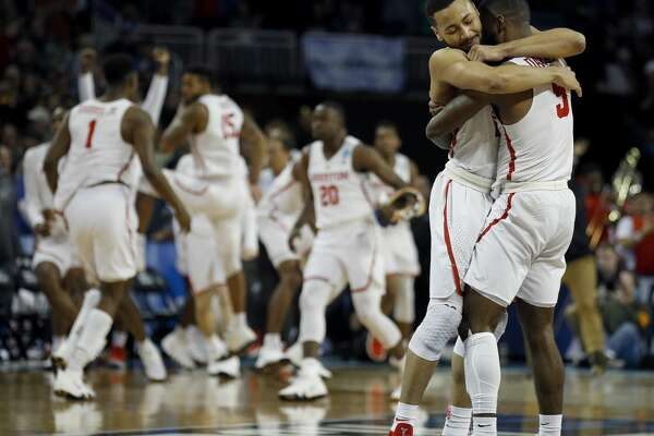 Houston guards Corey Davis Jr. (5) and Galen Robinson Jr. hug after their NCAA men's college basketball tournament first-round game against San Diego State Thursday, March 15, 2018, in Wichita, Kan. Houston won 67-65. (AP Photo/Charlie Riedel)
