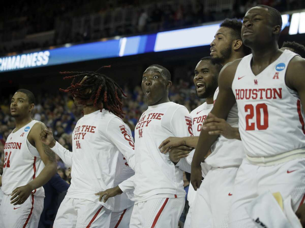Houston players including forwards Breaon Brady, left, and Gabe Grant (20) celebrate the go-ahead basket during the second half of an NCAA men's college basketball tournament first-round game against San Diego State, Thursday, March 15, 2018, in Wichita, Kan. Houston defeated San Diego State 67-65.(AP Photo/Orlin Wagner)