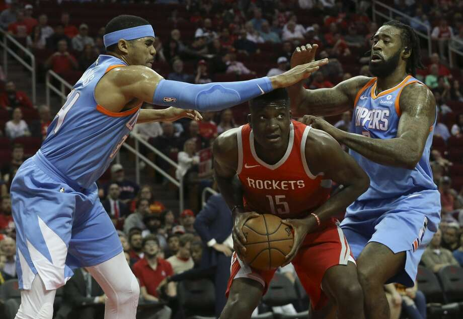 Houston Rockets center Clint Capela (15) is covered by LA Clippers players Tobias Harris, left, andD eAndre Jordan during the first quarter of the NBA game at Toyota Center on Thursday, March 15, 2018, in Houston. ( Yi-Chin Lee / Houston Chronicle ) Photo: Yi-Chin Lee/Houston Chronicle
