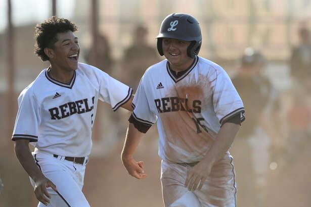 Lee's Austin Day (15) celebrates with Junior Alvarez (5) after scoring against Amarillo Tascosa March 15, 2018, at Ernie Johnson Field. James Durbin/Reporter-Telegram