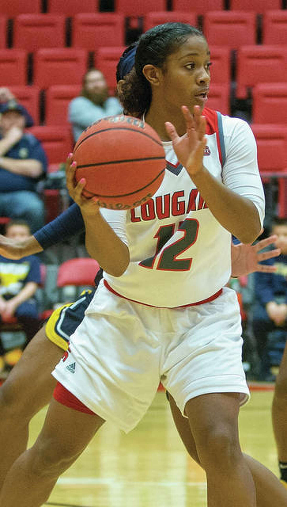 Edwardsville's Lauren White capped her 1,000-points career at SIUE on Wednesday night in the Cougars' WBI loss to Central Arkansas in Conway, Ark.